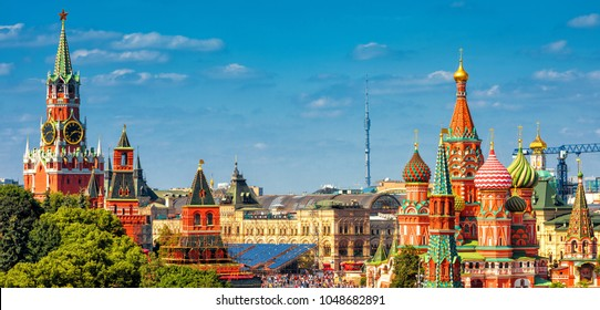 Panoramic view of the old Red Square with Moscow Kremlin and St Basil's Cathedral in summer, Moscow, Russia. It is the best-known sights of Moscow. Beautiful panorama of the heart of sunny Moscow.
