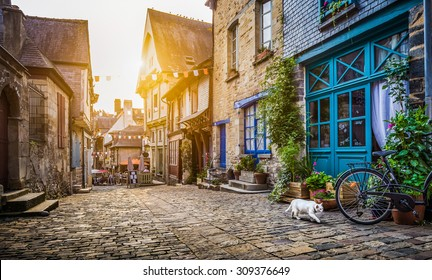 Panoramic view of old town in Europe in beautiful evening light at sunset with retro vintage Instagram style grunge filter and lens flare effect