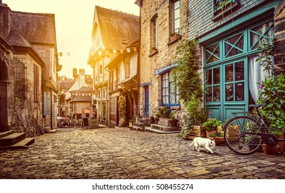 Panoramic view of old town in Europe in beautiful evening light at sunset with retro vintage Instagram style pastel toned grunge filter and lens flare sunlight effect in summer