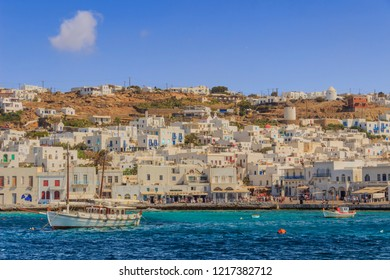 Panoramic view of old town and harbor of Mykonos, Cyclades, Greece. Panorama of traditional greek village with white houses in Cyclades Islands, Europe.