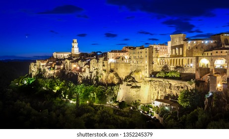 Panoramic view of an old town Pitigliano at the dusk, small old town in Maremma Region in Tuscany, Italy