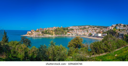 Panoramic view of the Old town of Ulcinj with the Kalaja castle above town beach, Montenegro