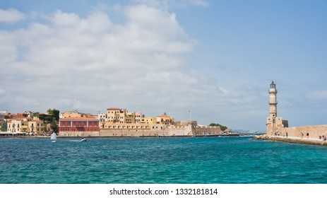 Panoramic view of the old venetian harbor with a lighthouse at Chania, island of Crete, Greece