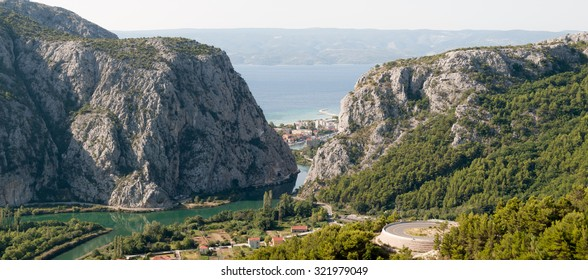 Panoramic view to Omis from the mountains with the river Cetina, the town, the adriatic sea and in the background the island of Brac.