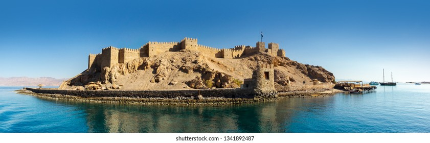 Panoramic view on an ancient Fortress of Saladin on the Pharaoh Island in the Gulf of Aqaba. Old Castle of Sultan Salah ad-Din in Taba, travel on Sinai and sea vacation on the Red Sea.