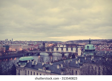 Panoramic view on the bridges of Prague and Vltava river on an early, cloudy morning. Image filtered in faded, washed out, retro, Instagram style; nostalgic, vintage travel concept. Cityscape.