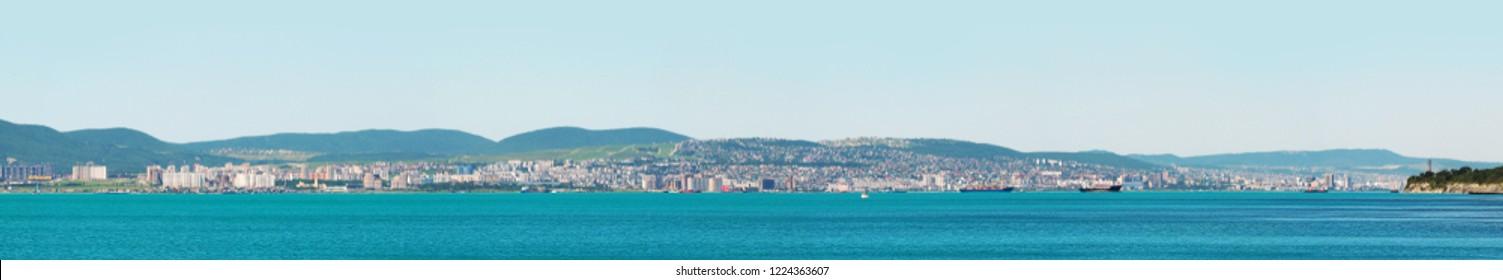Panoramic view on the city of Novorossiysk, Novorossiysk Bay of Black sea. Russian port town, Krasnodar region. Tourism, travel, summertime