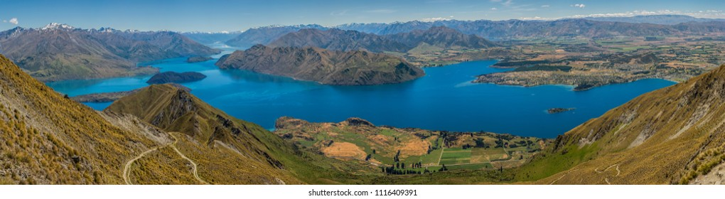 Panoramic view on a clear summer's day of Lake Wanaka from half way up Roy's Peak trail, South Island, New Zealand