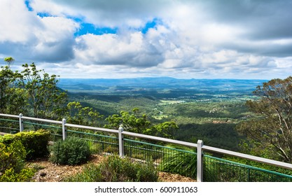 The panoramic view on flat lands, field with mountains in sunny day with big cumulus clouds  from Picnic Point Lookout in Toowoomba, Australia