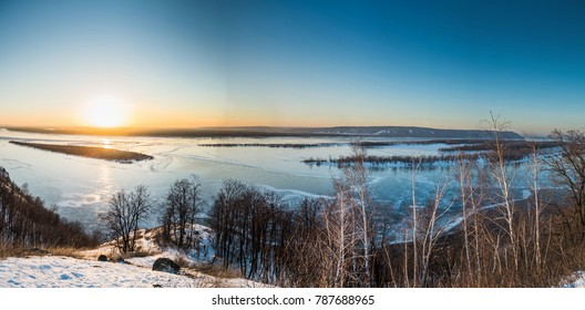 Panoramic view on frozen Volga river in winter during sunset from hill near Samara city