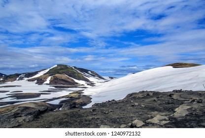 Panoramic view on Jokultungur geothermal area. Colorful rhyolite mountains with bright yellow, orange, brown stone under snow, Laugavegur route, Fjallabak Nature Reserve, Highlands of Iceland, Europe