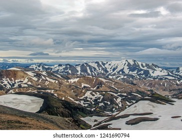 Panoramic view on Jokultungur geothermal area landscape from the top of the Sodull mountain, Hrafntinnusker. Colorful rhyolite mountains covered with snow, Laugavegur route, Fjallabak Park, Iceland