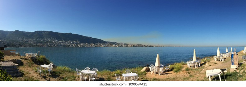 panoramic view on Jounieh and, from a distance,  Beirut in a cloud of pollution, shot on a sunny morning in Tabarja, Lebanon