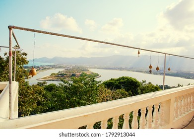 Panoramic view on Ko Samui city from a top of Wat temple where small golden bells are hanging.