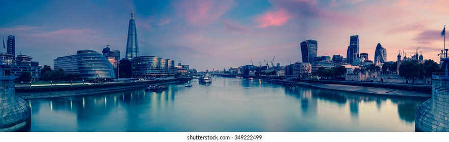 Panoramic view on London and Thames at twilight, from Tower Bridge with vintage effect effect