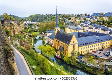 Panoramic view on Luxembourg City. Alzette river, church of St Jean du Grund and Abbey de Neumunster.