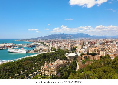 Panoramic view on Malaga City. Cityscape of Malaga with down town center with City Hall, Cathedral and Mediterranean Sea port harbor view from Gibralfaro viewpoint, Malaga, Andalusia, Spain.