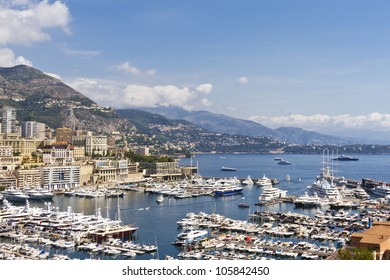 Panoramic view on marina with yachts and residential buildings in Monte Carlo, Monaco. Principality of Monaco is a sovereign city state, located on the French Riviera in Western Europe.
