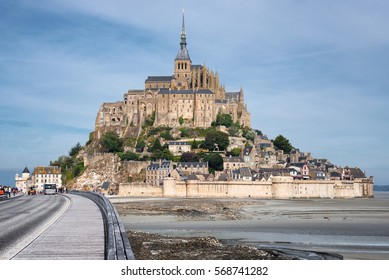 Panoramic view on Mont-Saint-Michel and a road to Abbey , France