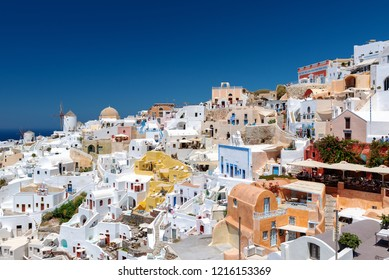 Panoramic view on mountain architecture of Oia town at Santorini island, Greece