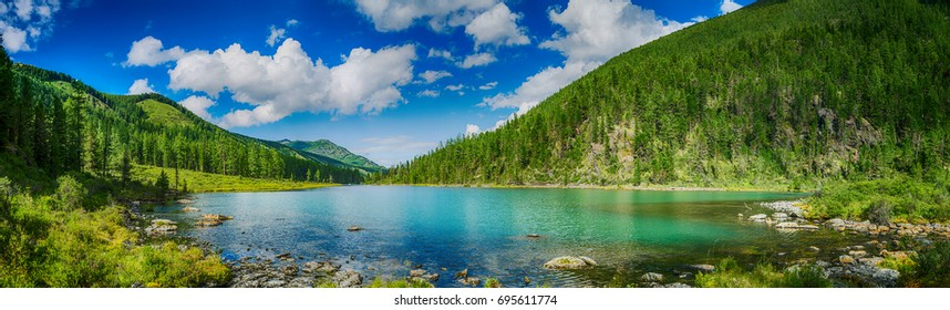 Panoramic view on mountain lake in front of mountain range, national park in Altai republic, Siberia, Russia