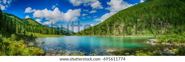 panoramic-view-on-mountain-lake-600w-695