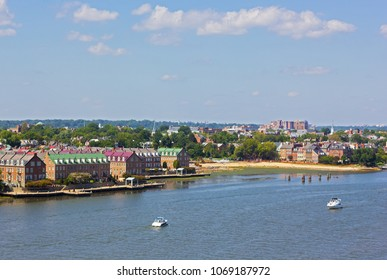 A panoramic view on Old Town Alexandria from the Potomac River, Virginia, USA. A river waterfront of nationally designated historic district in early fall.