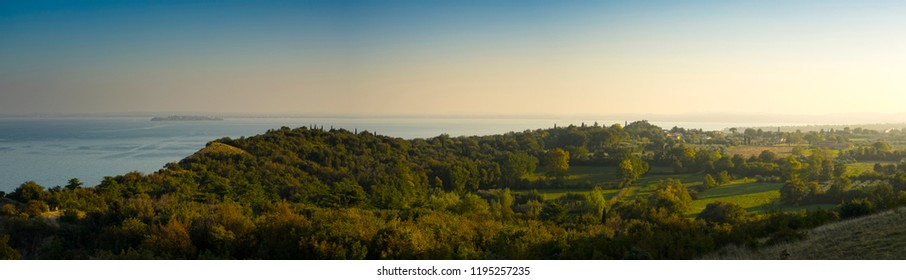 panoramic view on the parck of Montinelle ,on the Lake Garda at the sunset