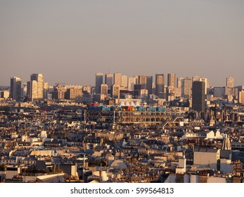 Panoramic view on Paris with Pompidou Museum and skyscrapers from Sacre Coeur in a sunset, Paris. France - MAY 2016