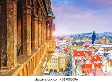 Panoramic view on Prague from the Castle on a sunny and snowy winter day, Praha, Czech Republic. Sunset , dramatic sky scene.
