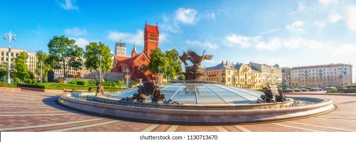 Panoramic view on Red Church or Church Of Saints Simon and Helen, Fountain at independence Square in Minsk, Belarus