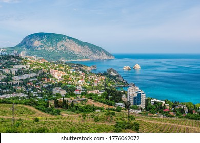 Panoramic view on resort city Gurzuf and Bear Mountain, Ayu-Dag, Yalta, Crimea. Sunny day. Copy space. The concept of an travel, relax, active and healthy life in harmony with nature.