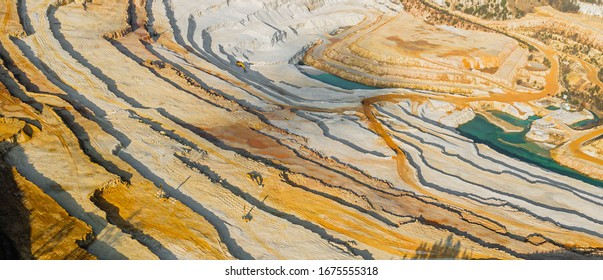 Panoramic view on a sandpit. Mining of ore and natural resources. Top view on a sandy texture.