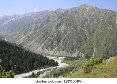 Panoramic view on a scenic green valley in Ala Archa national park in Tian Shan mountain range near Bishkek in Kyrgyzstan.