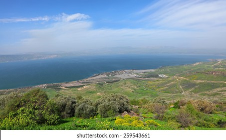 Panoramic view on Sea of Galilee - Kinneret (Lake Tiberias - is the largest freshwater lake in Israel) and agricultural valley. View from Galilee Mountains. Israel