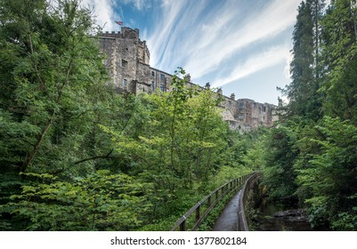 Panoramic view on Skipton Castle as seen from the footbridge in Skipton Woods