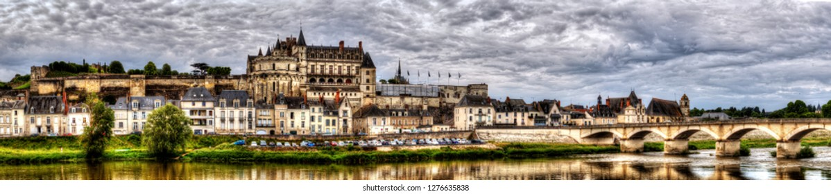 Panoramic view on the skyline of the historic city of Amboise with renaissance chateau across the river Loire. Loire valley, France