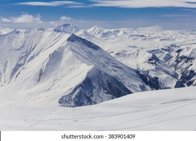 Panoramic view on snowy mountains