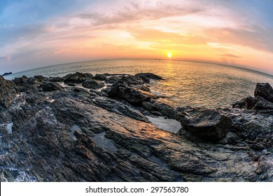 Panoramic view on sunset sea, small island, palms and boats  in fish-eye lens. Nature background