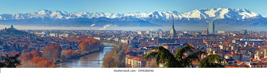 Panoramic view on Turin skyline, with the city center, Po river and Mole Antonelliana, in a clear winter morning with snowy alps on background