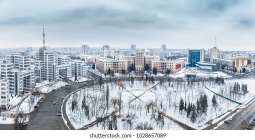 Panoramic view on Ukrainian city Kharkiv and one of the greatest squares in Europe - Freedom square. World UNESCO heritage list architecture. Beautiful winter snowy urban skyline scenery. Aerial view.