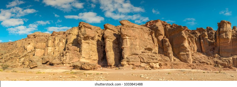 Panoramic view on unique stone formation - pillars of the Solomon King in Timna geological park that is located 25 km north of Eilat (Israel), combines beautiful scenery with unique geology, variety