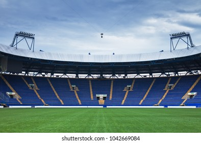"""Panoramic view of one empty of stadium """"Metalist"""" sectors with empty blue tribunes and searchlights of lighting. Kharkov, Ukraine, 16 june 2016"""