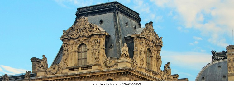 Panoramic view of one of the towers on the building of the Louvre in Paris, many details, blue sky, travel