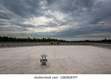 Panoramic view of a open empty square with surrounding wall against dramatic sky.
