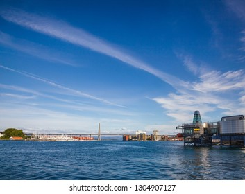 Panoramic view of Ostre Havn harbour of Stavanger at Byfjorden fjord with Grasholmen island, Stavanger City Bridge and Norwegian Petroleum Museum on a bright summer day, Norway, Scandinavia