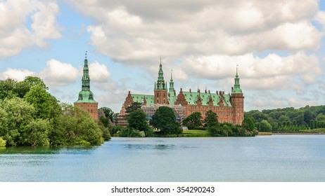 Panoramic view from the other side of the lake around Castle Frederiksborg Slot, Hillerod, near Copenhagen, Denmark