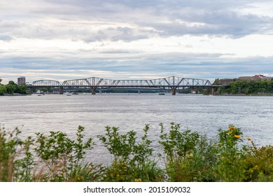 Panoramic view of Ottawa River and Alexandra Bridge from Ottawa to Gatineau city of Quebec, Canada in summer evening