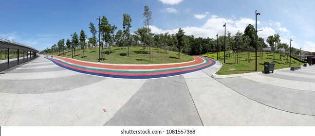 Panoramic view of an outdoor recreational park with colorful running tracks in Bukit Jalil, Kuala Lumpur, Malaysia.