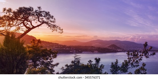 Panoramic view over a coastal town in France, French Riviera, like Canne or Saint Tropez. hills and a bay at sunset
